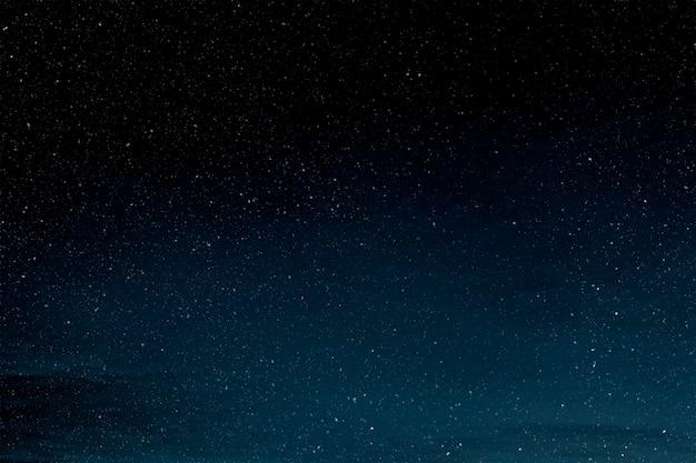 Ilustração do fundo do céu à noite estrelada