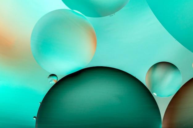 Ilustração gráfica de círculos verdes em fundo verde claro