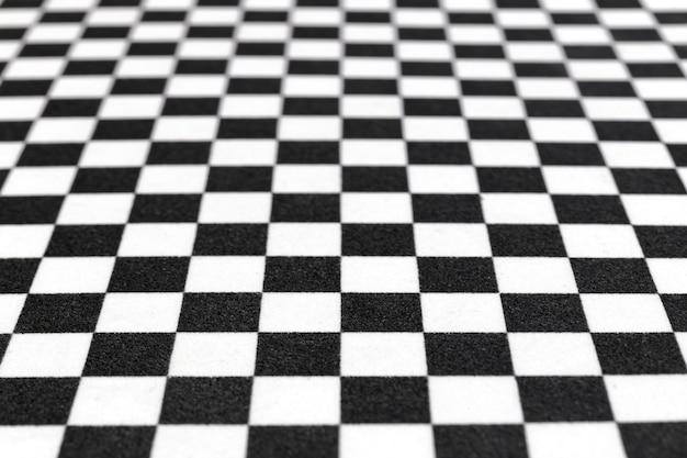 Imagem borrada ou desfocada do padrão de xadrez, imagem de fundo preto e branco