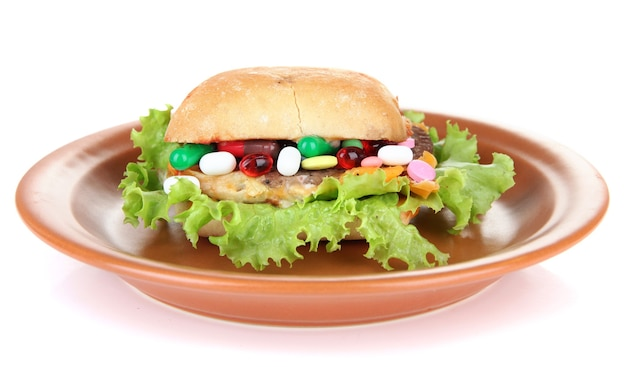 Imagem conceitual para o cuidado nutricional: diversas vitaminas e suplementos nutricionais em pão.