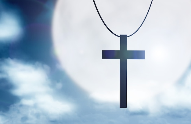 Imagem da cruz cristã com o fundo da cena noturna
