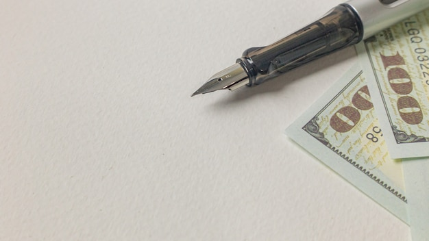 Imagem de caneta e notas para o conceito de negócio.