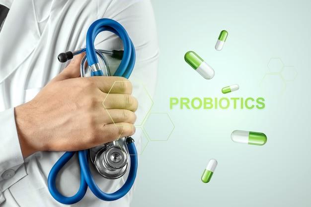 Imagem de closeup médico de comprimidos e probióticos de inscrição.