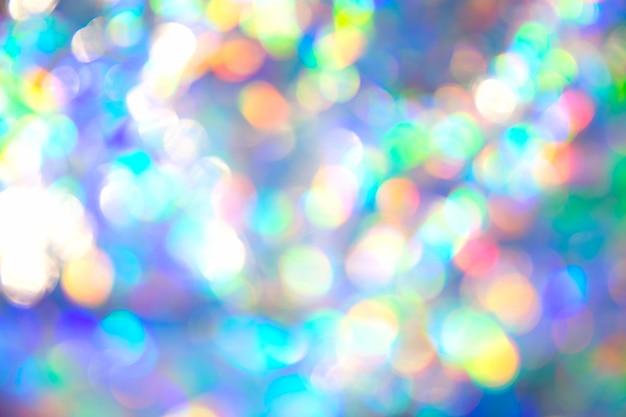 Imagem de textura abstrata radiante cenário festivo de folha metálica iridescente de bokeh holográfica
