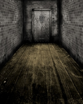 Imagem em estilo grunge de uma passagem que leva à porta de uma antiga prisão