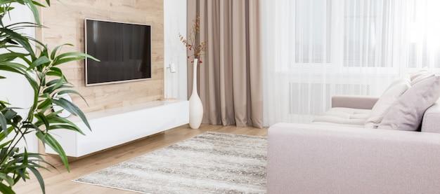 Imagem panorâmica de uma espaçosa sala de estar