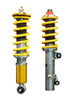 Imagem vertical de dois amortecedores amarelos, isolados no espaço em branco