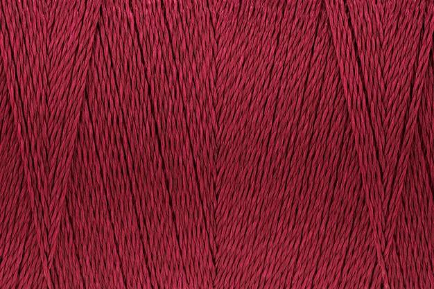 Imagens de macro de textura de fio vermelho fundo de cor carmesim
