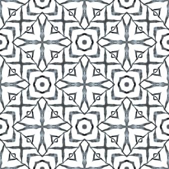 Impressão imaginativa pronta para têxteis, tecido de biquíni, papel de parede, embrulho. design de verão chique boho preto e branco. aquarela ikat repetindo a borda da telha. ikat repetindo design de trajes de banho.