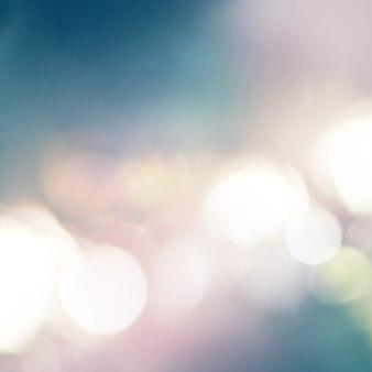 Incêndios leves e pontos de cor. pastel cores branco, azul, rosa em abstrato