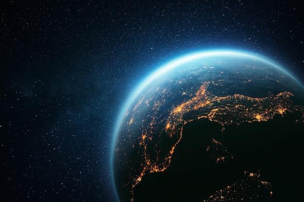 Incrível planeta terra com um brilho azul e luzes amarelas de cidades noturnas no espaço.