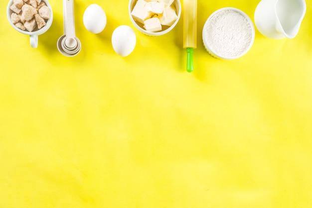 Ingredientes de panificação em fundo amarelo