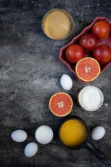 Ingredientes para cozinhar o bolo com laranja de sangue. conjunto de produtos para receita