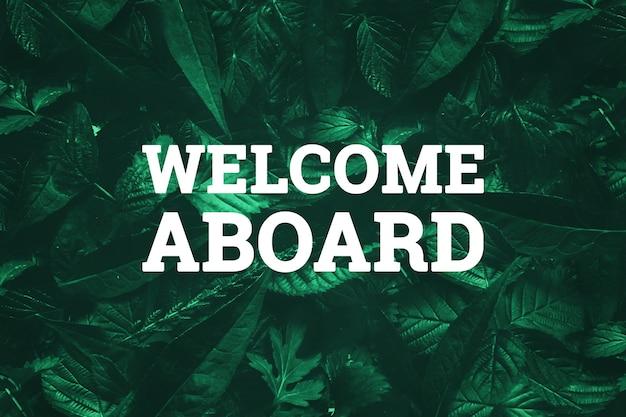 Inscrição branca, bem-vindo a bordo, sobre um fundo verde natural.