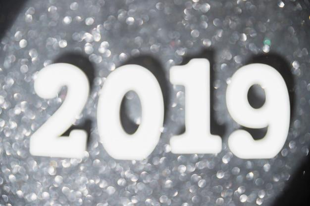 Inscrição de 2019 com bokeh na mesa