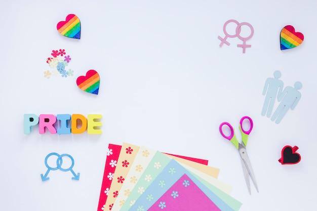 Inscrição de orgulho com ícones de casais homossexuais e corações do arco-íris
