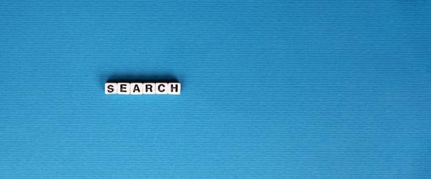 Inscrição de pesquisa com letras sobre fundo azul