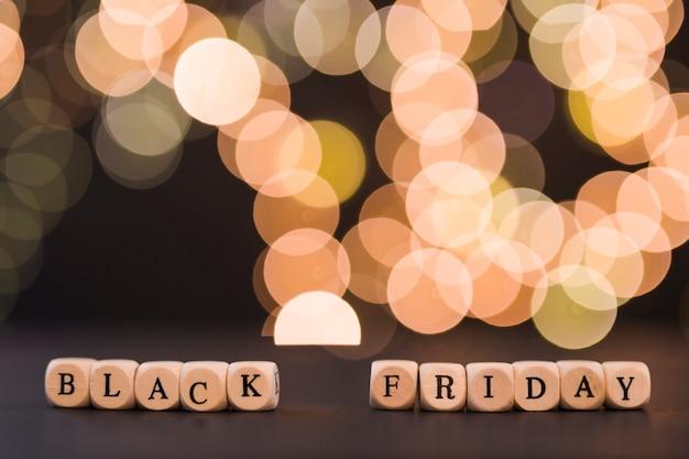 Inscrição de sexta-feira negra em cubos com bokeh