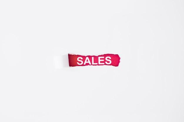 Inscrição de vendas sob papel rasgado