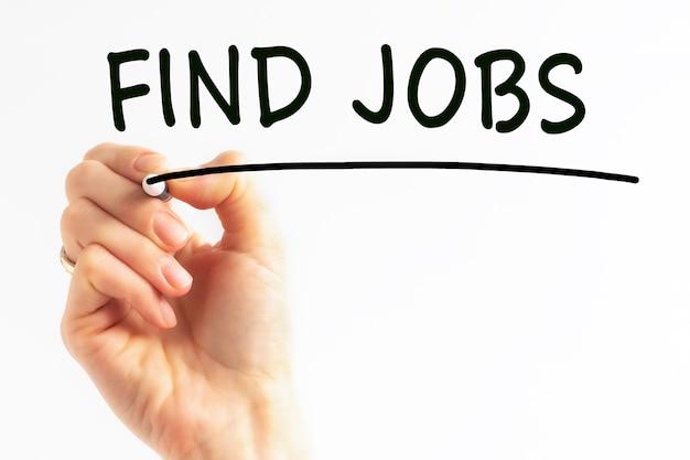 Inscrição escrita à mão encontrar empregos com marcador de cor preta, conceito, imagem de estoque