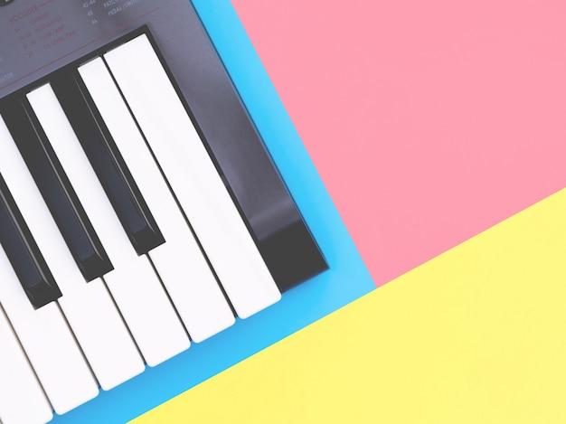 Instrumento de sintetizador de teclado de música no espaço da cópia azul para o conceito de cartaz de música