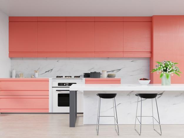 Interior da cozinha com a parede coral viva da cor em coral vivo do ano 2019.