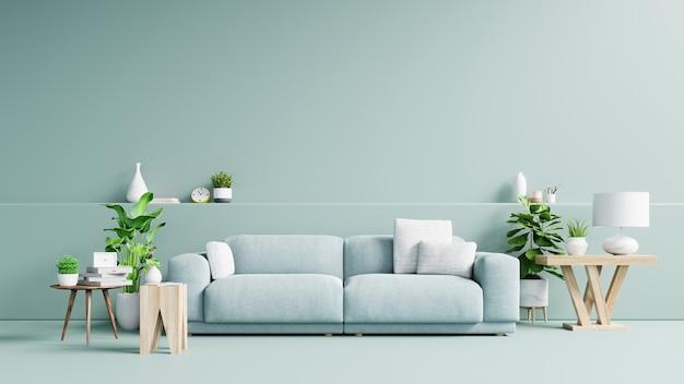 Interior da moderna sala de estar com sofá e plantas verdes, lâmpada, mesa na luz de fundo de parede verde.