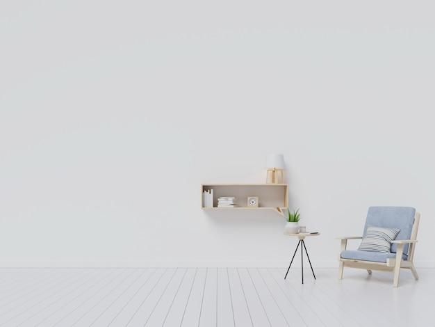 Interior da sala de estar com poltrona de veludo cinza, prateleira com livros sobre fundo de parede branca