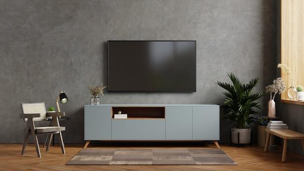 Interior da sala de estar tem tv no armário na sala de cimento com parede de concreto.