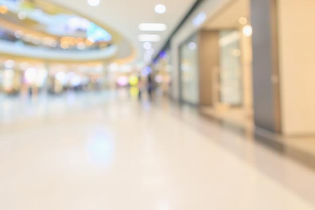Interior de loja de departamentos de shopping center de luxo moderno desfocar o fundo desfocado abstrato com luz bokeh
