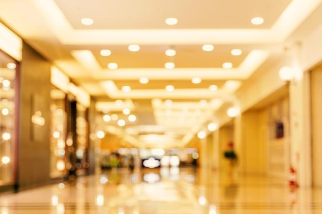 Interior de shopping center de loja de departamentos de luxo, desfocado abstrato com fundo bokeh, conceito de design de temporadas de compras