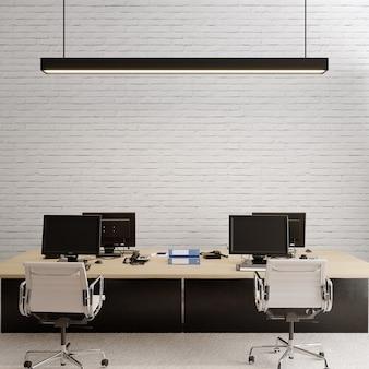 Interior de um escritório com mesa em frente à parede de tijolos brancos