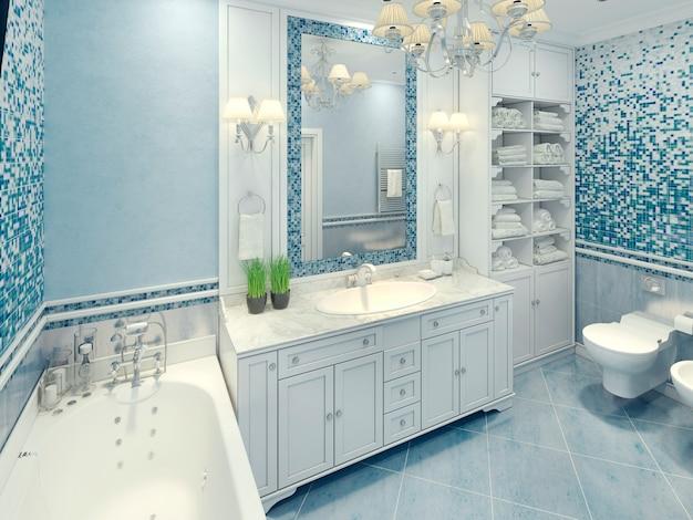 Interior do banheiro em estilo art déco com móveis brancos e fragmentos de mosaico na parede.