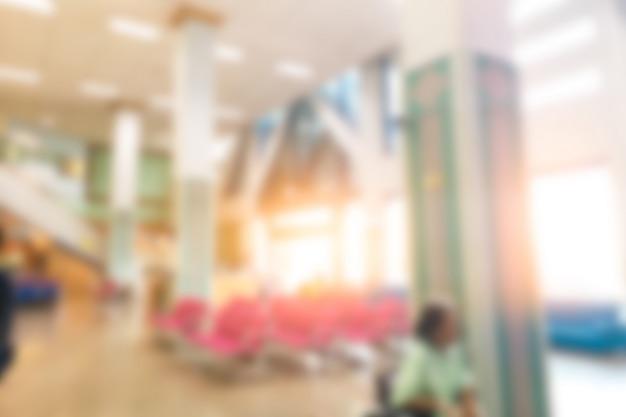 Interior do hospital do luxo do borrão abstrato e interior luxuosos bonitos da clínica para o fundo.
