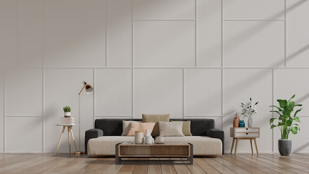Interior moderno da sala de visitas com sofá e plantas verdes, lâmpada, tabela na parede branca.