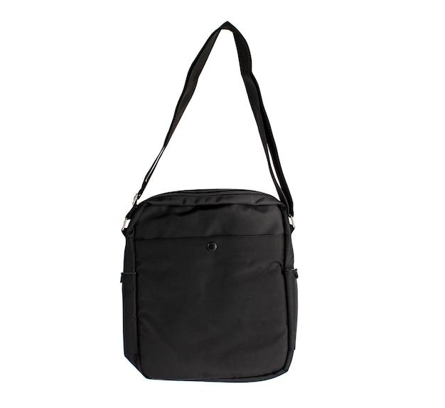 Isolado estúdio tiro closeup de novo pequeno casual moderno moderno na moda tecido preto mensageiro rider homens estilingue bolsa de bagagem com alça no fundo branco.