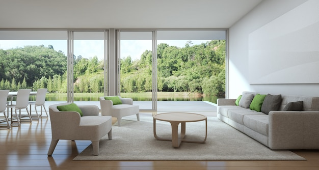 Jantar e sala de estar de casa de luxo com vista para o lago em design moderno.