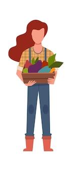 Jardineiro de mulher com colheita. trabalhador agrícola com vegetais biológicos, agricultora segurando uma caixa de madeira, produção de alimentos frescos ecológicos saudáveis, personagem de desenho vetorial plana isolada