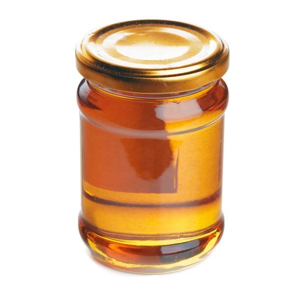 Jarra de vidro com doce mel isolado