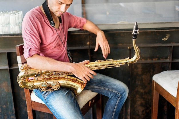 Jazzman musical artist playing saxofone concept