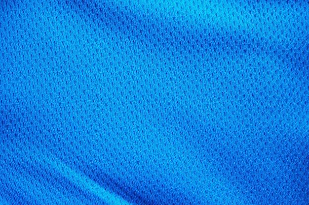 Jérsei de futebol de tecido azul para roupas esportivas com fundo de textura de malha de ar
