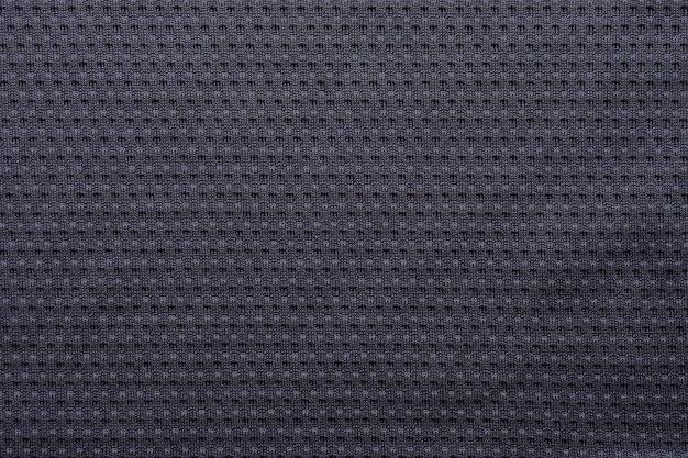 Jérsei de futebol de tecido preto para roupas esportivas com fundo de textura de malha de ar