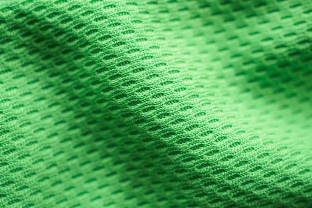 Jérsei de futebol de tecido verde para roupas esportivas com fundo de textura de malha de ar