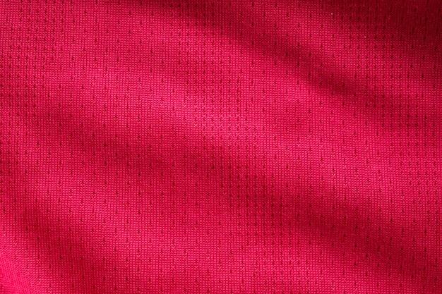 Jérsei de futebol de tecido vermelho para roupas esportivas com fundo de textura de malha de ar