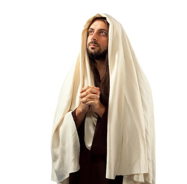 Jesus cristo reza com as mãos entrelaçadas