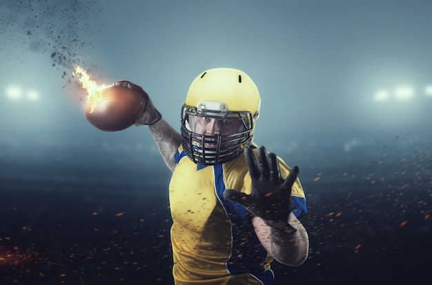 Jogador de futebol americano com bola em chamas
