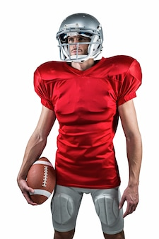 Jogador de futebol americano em jersey vermelho, olhando para longe