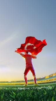 Jogador de futebol após o campeonato do jogo vencedor segura a bandeira da turquia. estilo de polígono