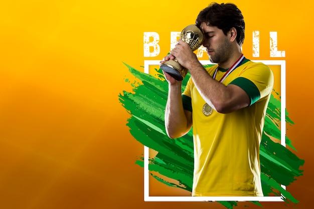 Jogador de futebol brasileiro, comemorando a vitória do campeão