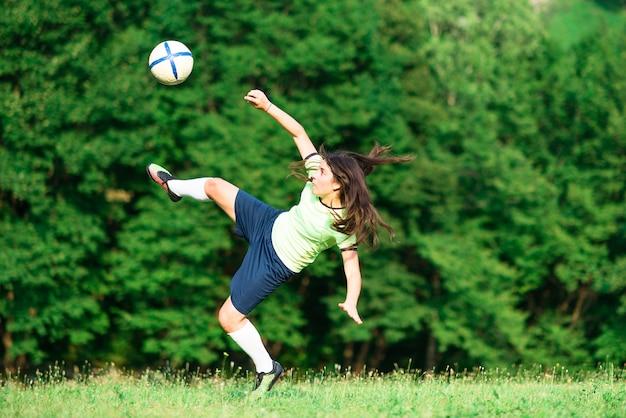 Jogador de futebol da mulher
